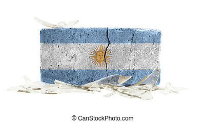 Brick with broken glass, violence concept, flag of Argentina