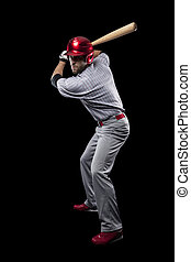 Baseball Player on a black background. Studio Shot.