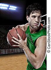 Brazilian Basketball player with a ball in his hands and a...