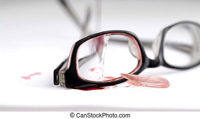 Broken glasses with blood on it