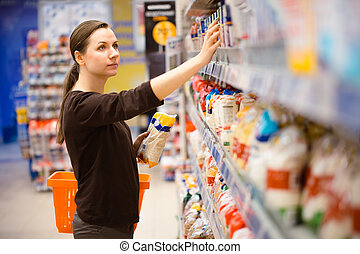 A young girl in a grocery supermarket - Beautiful young...
