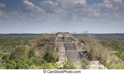 time-lapse of the mayan ruins at kalakmul, mexico the mayans...