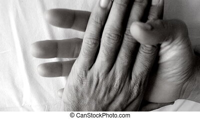 a male and female caressing each others hands