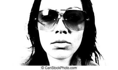 close up of the face of a beautiful woman as she dances with sunglasses