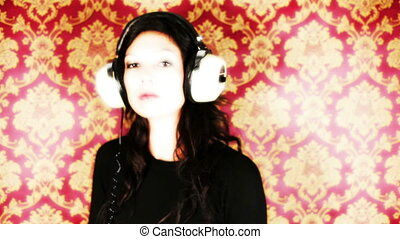 a sexy woman dances with retro white headphones against a classic wallpaper print