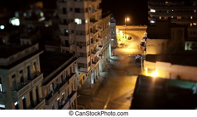 tilt and shift nighttime timelapse looking down onto the street in havana, cuba