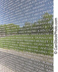 closeup of vietnam wall memorial names