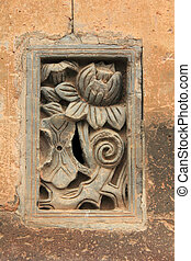 Zunhua, May 13: Carved works on a grey wall in the Eastern...
