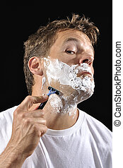 Man shaving - Handsome Caucasian man with shaving cream...