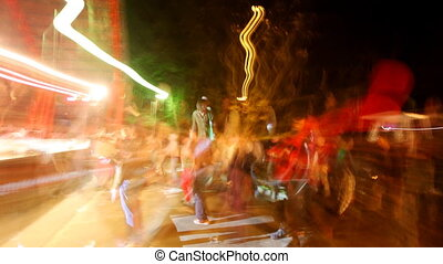 long exposed sequence of shots of a crowd dancing at an...