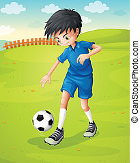 A boy with a blue uniform practicing at the hillside -...