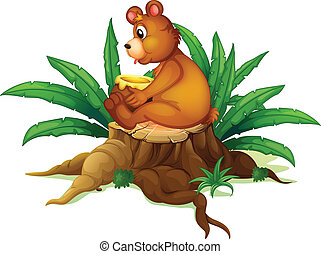 A bear sitting on a stump with leaves