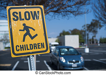 Slow children crossing sign in school parking lot