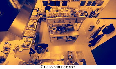 timelapse shot looking down on two chefs preparing food in a...