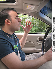 Road Rage - A young man seems to be experiencing some road...