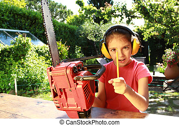 Pencil sharpener - Young girl using a chain saw to sharpen a...