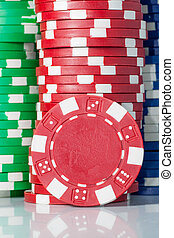 gambling casino chips - gambling casino color chips on table