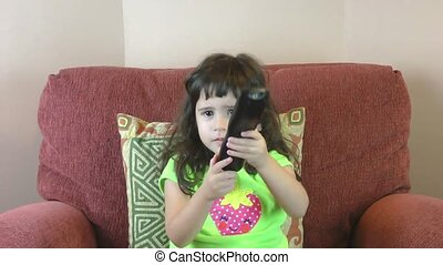 Frustrated little girl with tv remo
