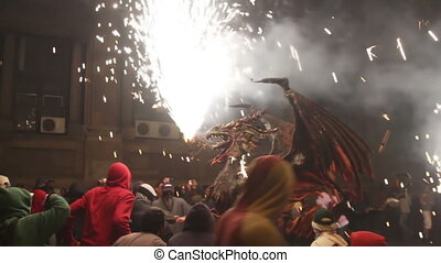 crowds in the street or the fire run, correfoc, barcelona spain