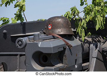 Nazi helmet lies on the gun battle - KIEV, UKRAINE - MAY 11...
