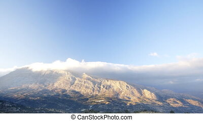 moving clouds over mountains in crete, greece