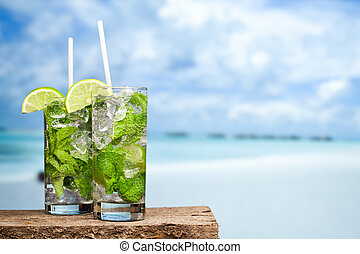 Cocktail mojito on beach - Cocktail mojito ice lemon straws...