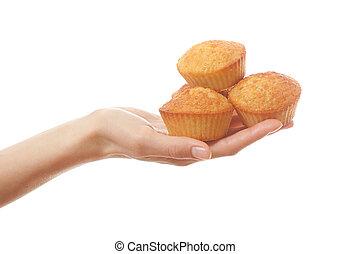 Hand holding heartshape cakes, isolated on white background