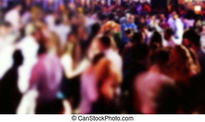 panning across a crowded dancefloor in a nightclub. blurred