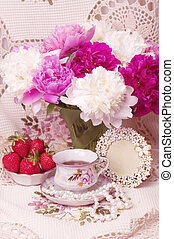 Vintage teacup with strawberry and spring pi-mesons