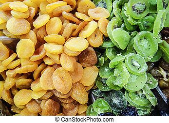Dried Apricot And Kiwi Fruit - A display of diried apricots...