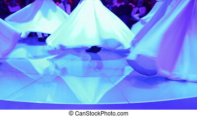 footage shot during a sema ceremony, of sufi dervish dancers...