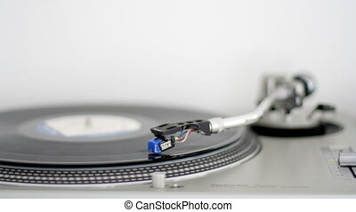 needle moves across vinyl on turntable