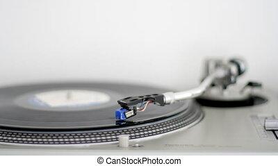 needle moves across vinyl on turntable