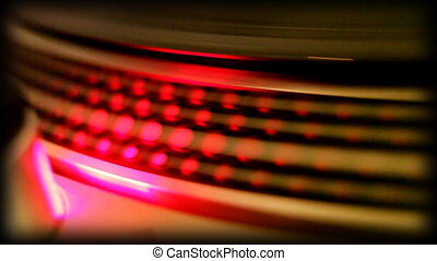 close-up of the rings on a turntable platter, whilst...