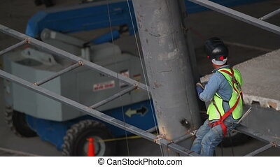 a construction worker on the metal girders of a building