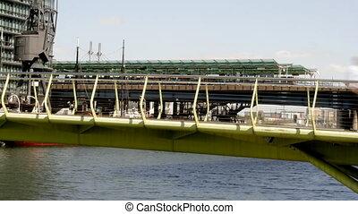 timelapse of crowds walking across a bridge in london docklands