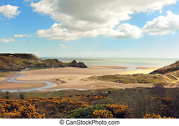 Three Cliffs bay in Wales - A view of Three Cliffs Bay on...