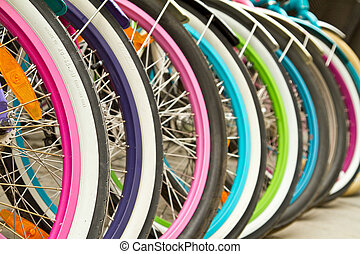 Colorfull wheels - Wheel detail of a group of bikes