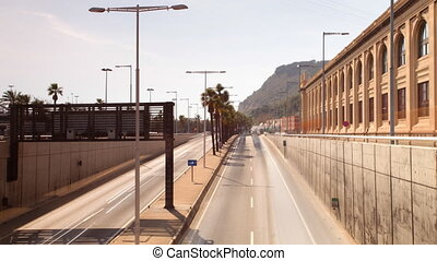 rush of traffic on motorway in timelapse scene, barcelona, spain