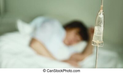 Infusion therapy - Patient in hospital bed recieving...