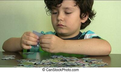 Child solving a puzzle