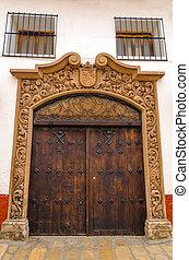 Old Wooden Door - Old wooden door and facade of a white...