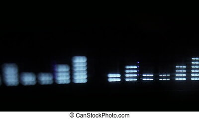 close-up of a hifi graphic equalizer shot with a tilt and shift lens to give a slight blur