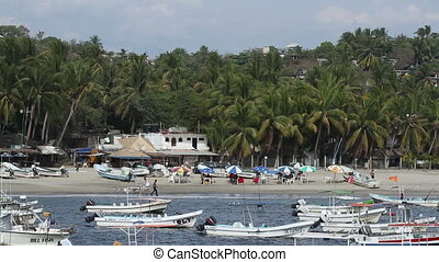small fishing boats in the harbour in puerto escondido, mexico
