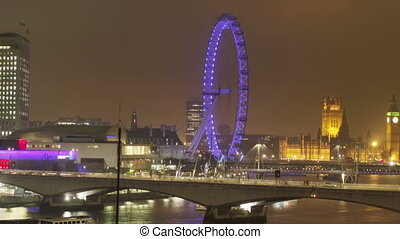 panning timelapse shot of the london eye and river thames at...