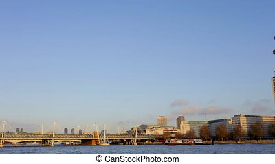 timelapse pan across the river thames, with the london eye...