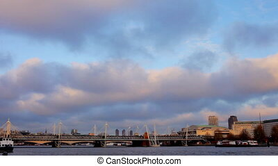 pan across the river thames with the london eye and boats in...