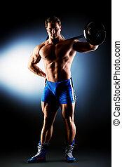 sportsman - Portrait of a handsome bodybuilder posing over...