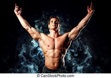 winner man - Portrait of a handsome muscular bodybuilder...