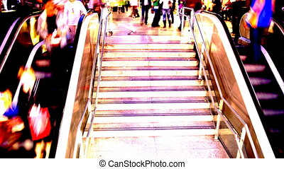people going up and down a subway entrance in barcelona...